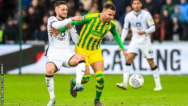 Matt Grimes battles with Hal Robson-Kanu