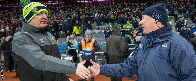 Managers Declan Bonner and Jim Gavin shakes hands after the Croke Park contest