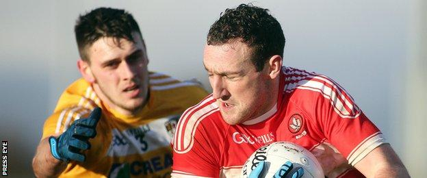 Derry's Shane Heavron battles with Antrim's Conor Burke last weekend