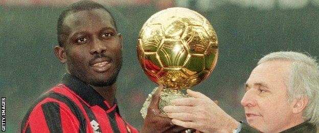 George Weah holds the Ballon d'Or in 1995