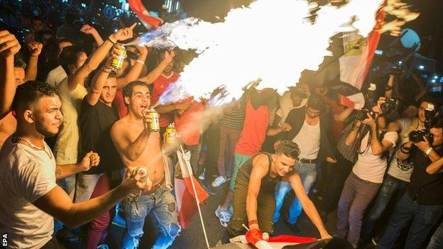 Egyptian fans in Cairo celebrate qualifying for their first World Cup in over a quarter of a century