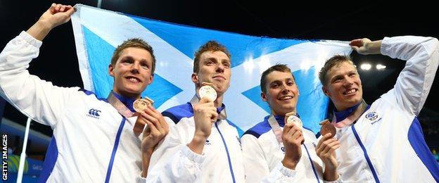 Duncan Scott, Stephen Milne, Daniel Wallace and Mark Szaranek celebrate their 4x200m relay bronze