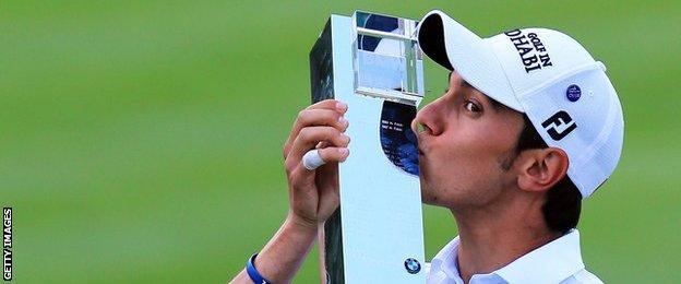 Matteo Manassero kisses the BMW PGA Championship trophy