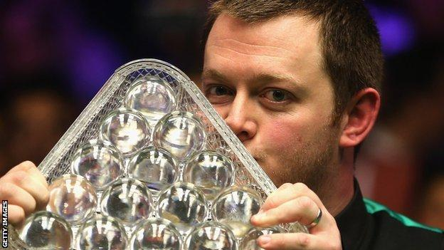Mark Allen kisses the Masters trophy