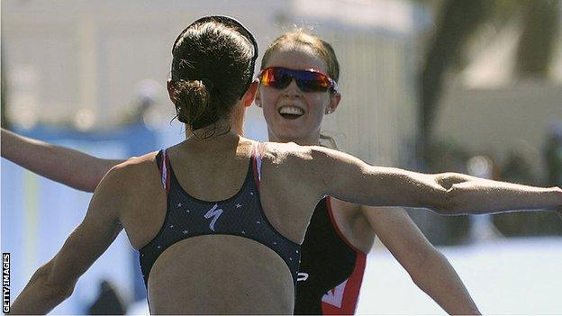 Non Stanford and race winner Gwen Jorgenson embrace after the Rio Olympic test triathlon