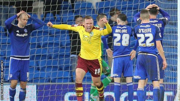 Matt Connolly (left) holds his head after scoring Burnley's equaliser