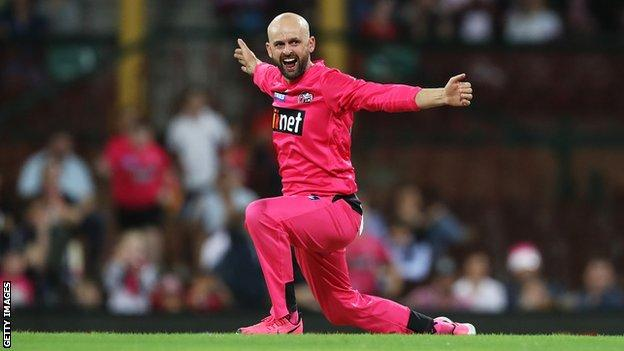 Sydney Sixers spinner Nathan Lyon celebrates taking the wicket of Melbourne Stars batsman Ben Dunk in the Big Bash final
