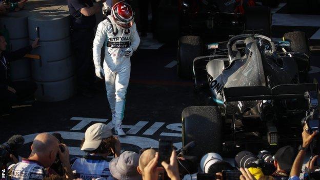 Lewis Hamilton looks at his Mercedes car after the Australian Grand Prix