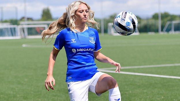 Toni Duggan playing with a football at her signing announcement