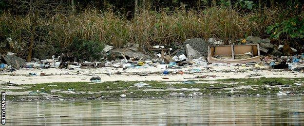 Pollution and debris along the banks of the Guanabara Bay, the site of the Olympic sailing events