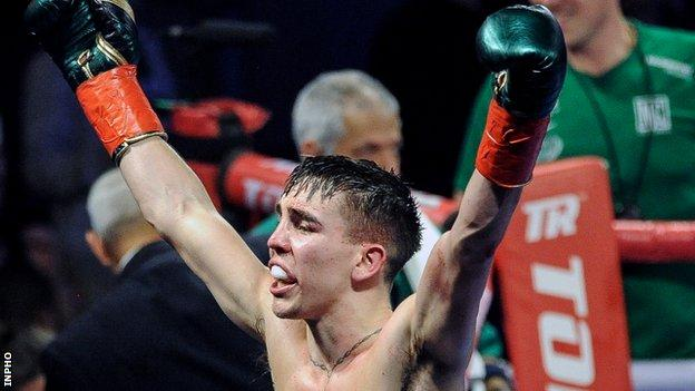 Michael Conlan celebrates after record his 11th straight professional victory