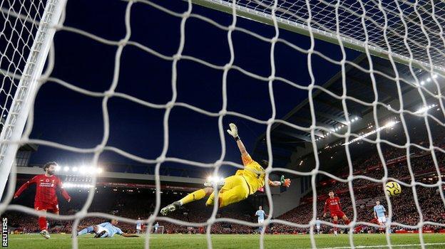 Mohamed Salah scores Liverpool's second goal against Manchester City