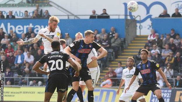 Oli McBurnie heads Swansea level