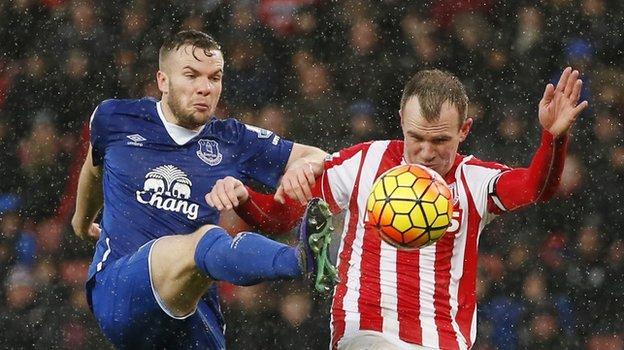 Everton midfielder Tom Cleverley (left) and Stoke's Glenn Whelan