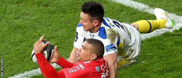 Mike Delany tackles Bryan Habana in the European Champions Cup final