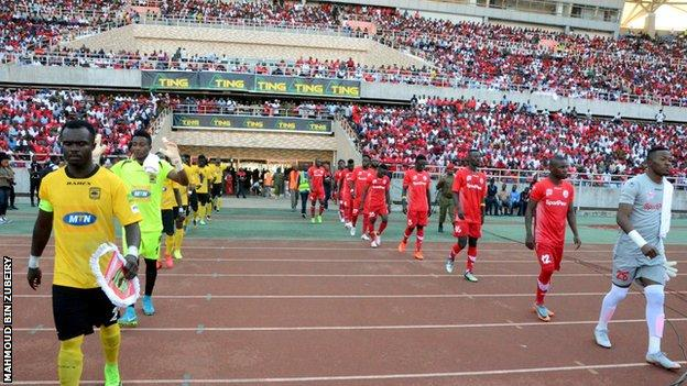 Simba in red before a match against Ghana's Asante Kotoko in 2018
