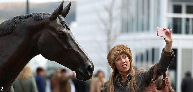 A racegoer takes a selfie with Best Mate