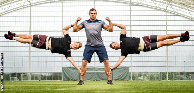 Sean Lamont, David Jackson and Tim Stevenson performing a human flag exercise