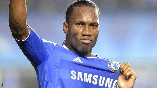 Didier Drogba celebrates scoring against Napoli in the Champions League in 2011-12