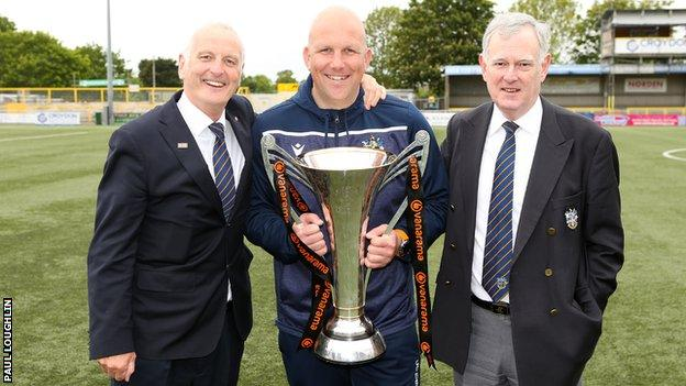 Sutton manager Matt Gray is flanked by chairman Bruce Elliot and vice chairman Adrian Barry