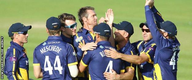 Glamorgan celebrate taking a wicket against Essex