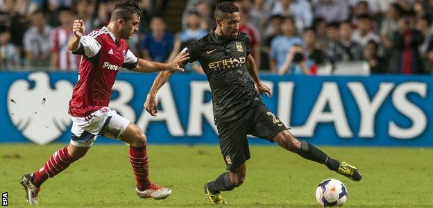 Jack Sealy with Manchester City's Gael Clichy during City's pre-season tour of 2013