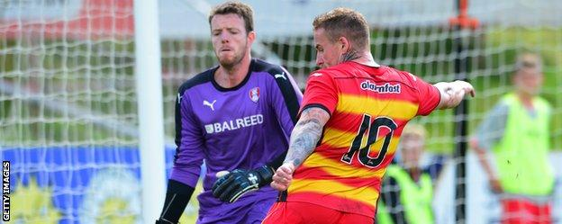 Rotherham United goalkeeper Adam Collin (left) in action against Partick Thistle