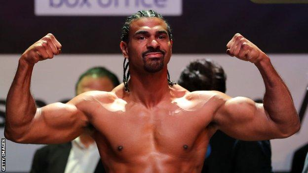David Haye poses on the scales