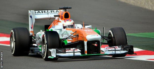Former Force India driver Paul Di Resta in action during the 2013 Indian Grand Prix 2013