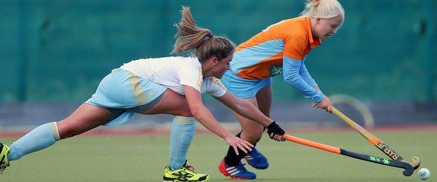 UCD's Chloe Watkins tackles Chloe Brown of Ards in an Irish Hockey League encounter