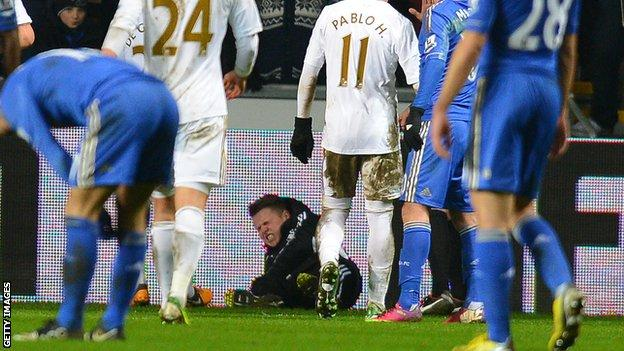 "Swansea ball boy Charlie Morgan, apparently ""fell on top of the ball"""