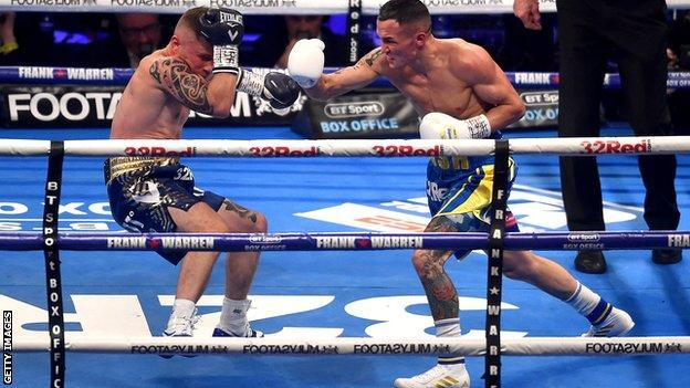 Josh Warrington nearly sends Carl Frampton crashing to the canvas during their IBF featherweight word title fight