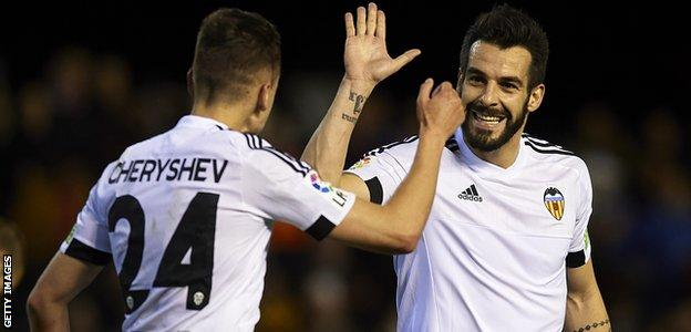 Alvaro Negredo and Denis Cheryshev celebrate