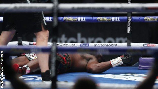 Dillian Whyte on the canvas after being knocked out by Alexander Povetkin