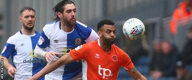 Blackpool defender Curtis Tilt (right)