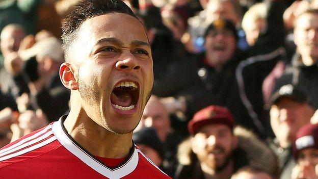 Manchester United winger Memphis Depay celebrates scoring a goal