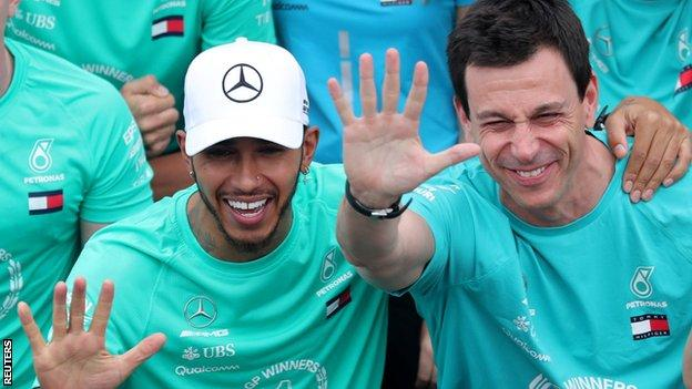 Lewis Hamilton and Toto Wolff celebrate winning the constructors' championship
