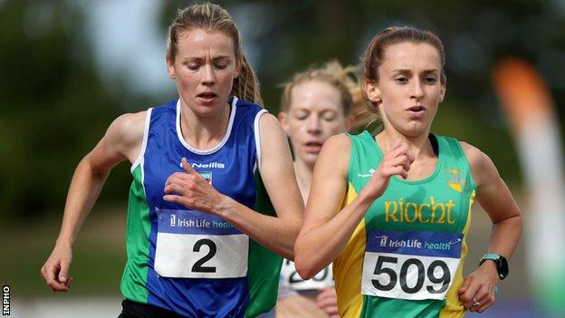 Emma Mitchell is on the shoulder of Shona Heaslip in the women's 5,000m