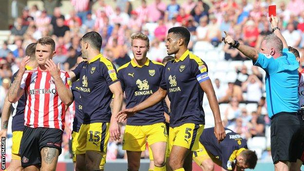 Sunderland midfielder Max Power (left) was given a straight red card for a bad tackle on Oxford United's Marcus Browne