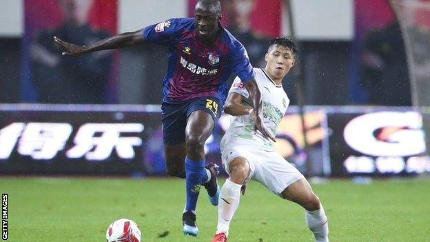 Yaya Toure playing for Qingdao Huanghai