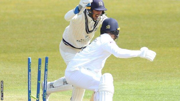 John Simpson stumps Hampshire batsman Joe Weatherley off Ethan Bamber