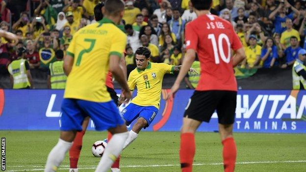 Philippe Coutinho scores with a free-kick