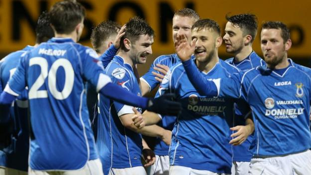Dungannon Swifts players congratulate Cormac Burke after he scored the final goal in their 5-1 win at home to Warrenpoint Town