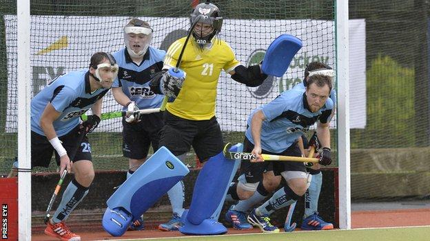 Lisnagarvey defend against UCD at Comber Road