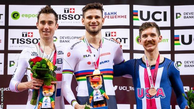 Britain's silver-medallist John Archibald (left), Italy's gold-medallist Filippo Ganna (centre) and American bronze-medallist Ashton Lambie (right) on the podium for the men's 4km individual pursuit at the Track Cycling World Cup in Minsk