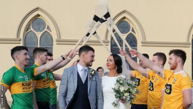 Creggan and Antrim players form a guard of honour for Conor McCann at his wedding