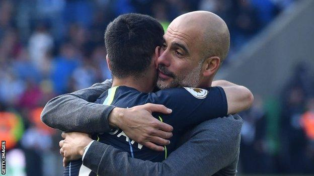 Pep Guardiola and Ilkay Gundogan embrace after winning the 2019 Premier League title