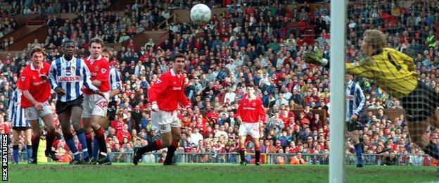 Steve Bruce scores against Sheffield Wednesday in 1993
