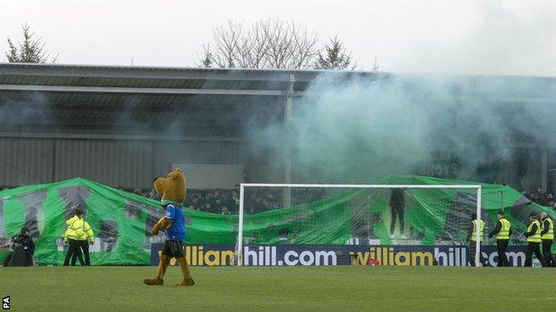 Smoke bombs are thrown at Stair Park