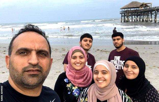 Raed Ahmed and his children pictured in 2019